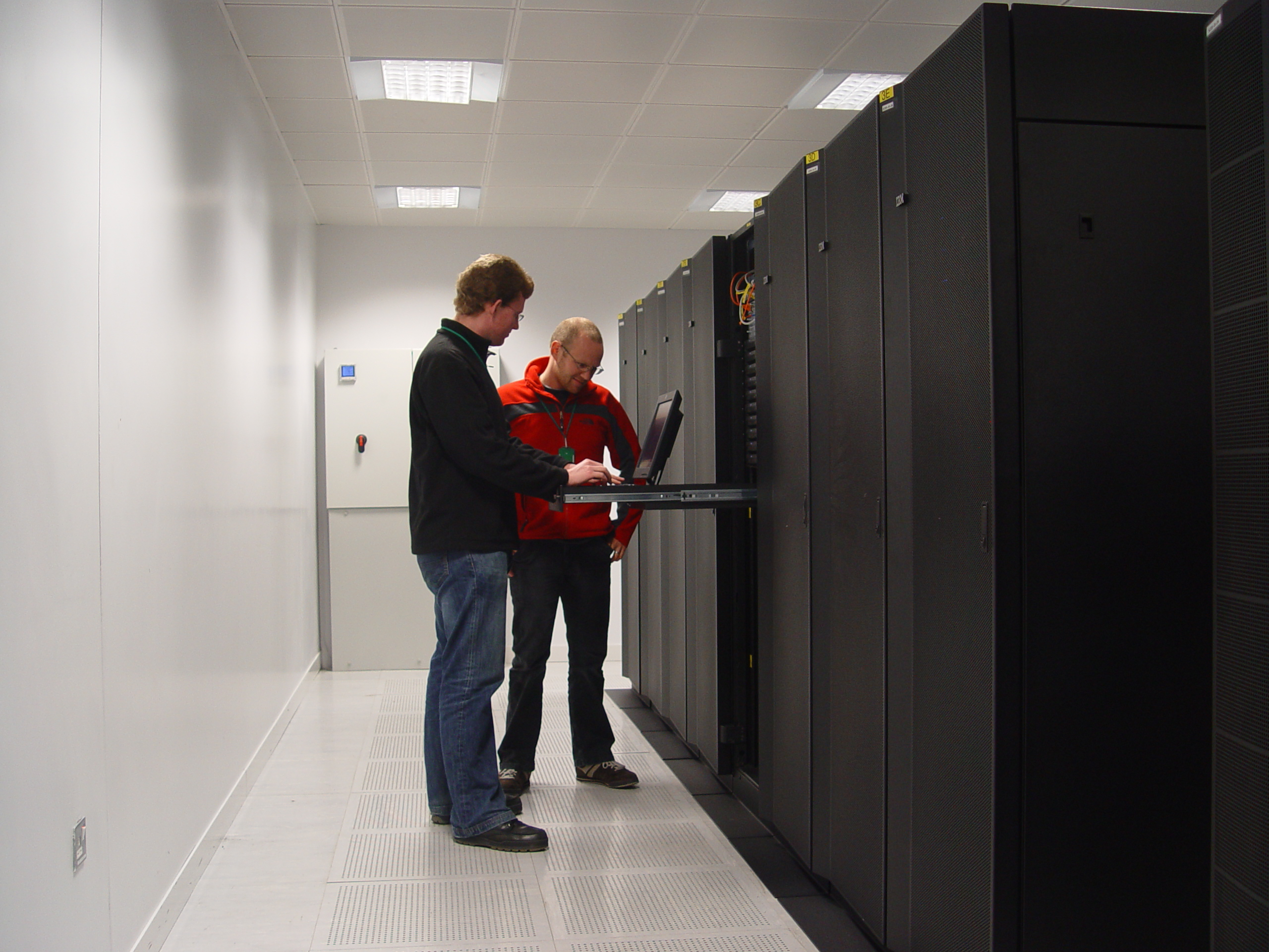 Walton supercomputer with ICHEC systems administrators Eoin McHugh (left) and Niall Wilson (right)